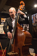 Tetsu Suzuki, a maker and resstorer of string instruments and bows, plays a double bass.
