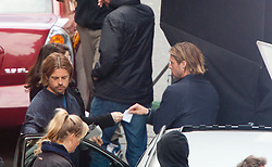 """Day two of filming. Brad Pitt and his body double Phil Ball on the set of the movie """"World War Z"""" being shot in the city centre of Glasgow. The film, which is set in Philadelphia, is being shot in various parts of Glasgow, transforming it to shoot the post apocalyptic zombie film."""