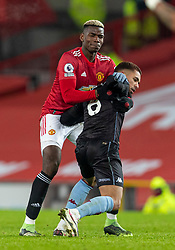 MANCHESTER, ENGLAND - Friday, January 1, 2020: Manchester United's Paul Pogba grapples with Aston Villa's Douglas Luiz during the New Year's Day FA Premier League match between Manchester United FC and Aston Villa FC at Old Trafford. The game was played behind closed doors due to the UK government putting Greater Manchester in Tier 4: Stay at Home during the Coronavirus COVID-19 Pandemic. (Pic by David Rawcliffe/Propaganda)