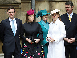 Members of the Royal family, Princess Eugenie and her fiance Jack Brooksbank, the Princess Royal and her husband Vice Admiral Sir Timothy Laurence and Princess Beatrice (in white) wait for Queen Elizabeth II to arrive for the Easter Mattins Service at St George's Chapel, Windsor Castle, Windsor.