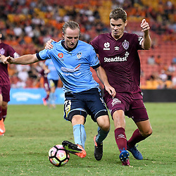 BRISBANE, AUSTRALIA - FEBRUARY 3: Rhyan Grant of Sydney is fouled by Thomas Kristensen of the Roar during the round 18 Hyundai A-League match between the Brisbane Roar and Sydney FC at Suncorp Stadium on February 3, 2017 in Brisbane, Australia. (Photo by Patrick Kearney/Brisbane Roar)