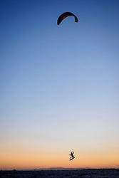 United States, California, Sherman Island County Park, Kiteboarder at sunset