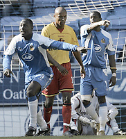 Photo: Andi Thompson.<br />Wigan Athletic v Watford. The Barclays Premiership. 23/09/2006.<br />Wigan's Emile Heskey (L) runs to the Referee, as the Wigan goal is initially not given.