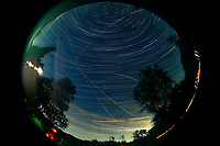 Night Sky Star Trails Image. Composite of 211 images taken with a Nikon D810a camera and 8-15 mm telephoto lens (200 ISO, 10 mm, f/8, 120 sec).