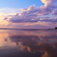 """""""To the Right of Sunset""""<br /> <br /> Billowing clouds mirrored on a lake at sunset!!<br /> <br /> Sunset Images by Rachel Cohen"""