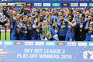 AFC Wimbledon players celebrate after winning the Sky Bet League 2 Play-off final. Skybet football league two play off final match, AFC Wimbledon v Plymouth Argyle at Wembley Stadium in London on Monday 30th May 2016.<br /> pic by John Patrick Fletcher, Andrew Orchard sports photography.