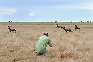 Impressionen aus dem Liuwa Plain Nationalpark in Sambia mit Fotografen am Werk mit Wildhunden.