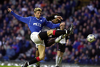 Rangers v  Motherwell, Scottish Premier Division.<br />Ibrox Park.       Pic Ian Stewart, December 10th. 2000.<br /><br />Tore Andre Flo shoots past Benito Kemble  and the post, before goingh off injured