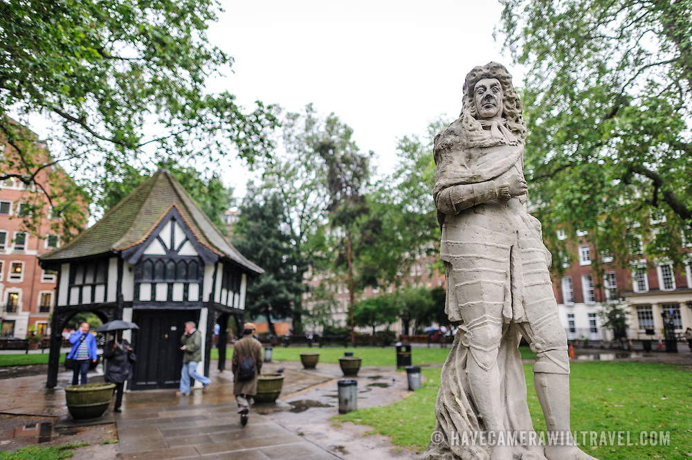 The statue of King Charles II, carved by Caius Gabriel Cibber in 1681 and since restored, stands in the center of Soho Square (originally King's Square) in the City of Westminster, London, UK. At the center of the square stands a distinctive Tudor-style gardener's hut.