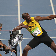 Athletics - Olympics: Day 13  Usain Bolt of Jamaica celebrates with his lightning bolt pose after winning the Men's 200m Final at the Olympic Stadium on August 18, 2016 in Rio de Janeiro, Brazil. (Photo by Tim Clayton/Corbis via Getty Images)