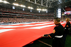 18 Jan 2009: US Milatary personnel hold a field size American Flag before the NFC Championship game between the Arizona Cardinals and the Philadelphia Eagles on January 18th, 2009. The Cardinals won 32-25 at University of Phoenix Stadium in Glendale, Arizona. (Photo by Brian Garfinkel)