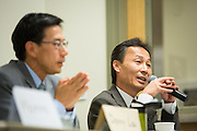 Vance Vuong talks about overcrowding at Milpitas High School, as Danny Lau (foreground) listens, during the Milpitas Unified School District Board of Education forum at the Barbara Lee Senior Center in Milpitas, California, on October 2, 2014. (Stan Olszewski/SOSKIphoto)