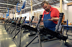 HERSTAL, BELGIUM - APRIL-11-2003 - Machine guns are assembled by hand at the FN Herstal weapons fabrication plant near Liege, Belgium. (PHOTO © JOCK FISTICK)