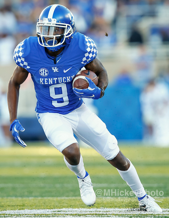 LEXINGTON, KY - SEPTEMBER 30: Garrett Johnson #9 of the Kentucky Wildcats runs the ball during the game against the Eastern Michigan Eagles at Commonwealth Stadium on September 30, 2017 in Lexington, Kentucky. (Photo by Michael Hickey/Getty Images) *** Local Caption *** Garrett Johnson