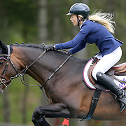 NORTH SALEM, NEW YORK - May 15: Liubov Kochetova, Russia, riding Balou De Reventon, in action during The $50,000 Old Salem Farm Grand Prix presented by The Kincade Group at the Old Salem Farm Spring Horse Show on May 15, 2016 in North Salem. (Photo by Tim Clayton/Corbis via Getty Images)