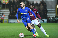 Wimbledon defender Dylan Connolly(16) in action during the The FA Cup fourth round match between AFC Wimbledon and West Ham United at the Cherry Red Records Stadium, Kingston, England on 26 January 2019.