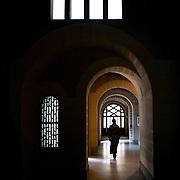 A monk walks in the corridor made by Dom Paul Bellot in 1937. It is in this place that the monks change their clothes.  Solesmes 08-01-2016 <br /> Un moine déambule dans la coulerie réalisée par Dom Paul Bellot en 1937. C'est en ce lieu que se changent les moines. Solesmes le 18-10-19