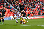Portsmouth FC goalkeeper Craig MacGillivray (15) takes ball safe from Doncaster Rovers forward Alfie May (19) and Portsmouth FC defender Jack Whatmough (16) during the EFL Sky Bet League 1 match between Doncaster Rovers and Portsmouth at the Keepmoat Stadium, Doncaster, England on 25 August 2018.Photo by Ian Lyall.