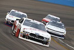 March 10, 2018 - Avondale, Arizona, United States of America - March 10, 2018 - Avondale, Arizona, USA: Cole Custer (00) brings his car through the turns during the DC Solar 200 at ISM Raceway in Avondale, Arizona. (Credit Image: © Chris Owens Asp Inc/ASP via ZUMA Wire)