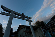 A Torii gate in the  abandoned village of Tsushima in Fukushima, Japan. Friday May 4th 2012. After the explosions at the daichi nuclear plant caused by the March 11th 2011 earthquake and tsunami, high levels of radiactive contamination in this village has made it uninhabitable.