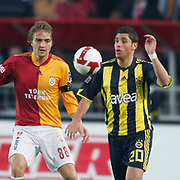 Galatasaray's Caner ERKIN (L) and Fenerbahce's Ozer HURMACI (R) during their Turkish superleague soccer derby match Galatasaray between Fenerbahce at the AliSamiYen Stadium at Mecidiyekoy in Istanbul Turkey on Sunday, 28 March 2010. Photo by Aykut AKICI/TURKPIX