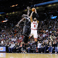 29 January 2012: Chicago Bulls power forward Carlos Boozer (5) takes a jumpshot over Miami Heat center Joel Anthony (50) during the Miami Heat 97-93 victory over the Chicago Bulls at the AmericanAirlines Arena, Miami, Florida, USA.