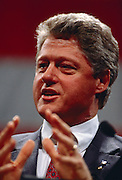 President Bill Clinton gestures while speaking