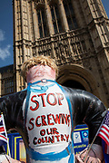 Brexit protester with an inflatable Boris Johnson and a message stop screwing our country in Westminster on the day after Parliament voted to take control of Parliamentary proceedings and prior to a vote on a bill to prevent the UK leaving the EU without a deal at the end of October, on 4th September 2019 in London, England, United Kingdom. Yesterday Prime Minister Boris Johnson faced a showdown after he threatened rebel Conservative MPs who vote against him with deselection, and vowed to aim for a snap general election if MPs succeed in a bid to take control of parliamentary proceedings to allow them to discuss legislation to block a no-deal Brexit.