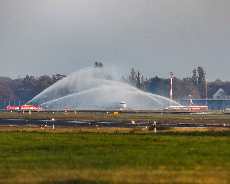 Airport fire trucks hose water (as a tribute) on an AIRFRANCE jet at Tegel Airport (TXL) prior to the final departure made from the historic airport, Berlin, Germany, November 8, 2020. After more than 60 years Berlin's tiny northern airport is set to shut down all operations, with a final departure flight by AirFrance to Paris. (Photos by Omer Messinger)