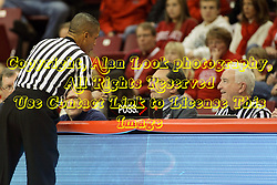 16 November 2014:  Referee Verne Harris speaks with the bench official and the clock operator during an NCAA non-conference game between the Utah State Aggies and the Illinois State Redbirds.  The Aggies win the competition 60-55 at Redbird Arena in Normal Illinois.