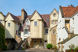 Daytime view of old houses in White Horse Close in Canongate, Edinburgh Old Town, Scotland, UK