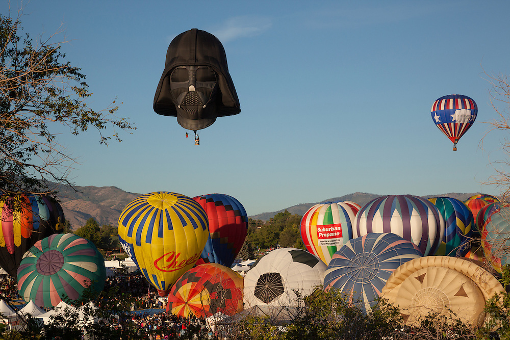 """""""Great Reno Balloon Race 11"""" - Photograph of hot air balloons lifting off during the mass ascension at the 2012 Great Reno Balloon Race."""