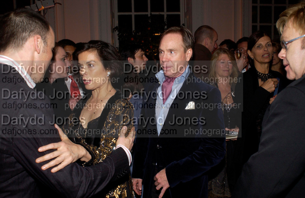 David Furnish,  Bianca Jagger,Tommy Hilfiger and Sir Elton John,. Mario Testino, Bianca Jagger and Kenneth Cole celebrate Women to Women: Positively Speaking. - A publication to raise awareness of women living with Aids. The Orangery, Kensington Palace. 2 December 2004. ONE TIME USE ONLY - DO NOT ARCHIVE  © Copyright Photograph by Dafydd Jones 66 Stockwell Park Rd. London SW9 0DA Tel 020 7733 0108 www.dafjones.com