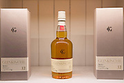 75cl bottles of 12-year-old Glenkinchie single malt Scotch Whisky on display for sale at shop on visitors tour at Talisker Distillery, Isle of Skye, Scotland