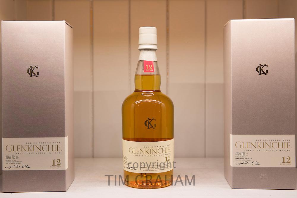 75cl bottles of 12-year-old Glenkinchie single malt Scotch Whisky on display for sale at shop on visitors tour at Talisker Distillery, Isle of Skye, Scotland