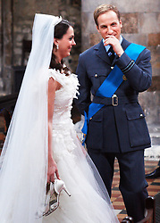 STRICT EMBARGO TO 00:01 FRIDAY 15 APRIL 2011 © licensed to London News Pictures. LONDON, UK  12/04/11. Katherine Middleton and Prince William. The filming of a new T-Mobile advert in which Kate Middleton and Prince William lookalikes pretend to get married at a mock royal wedding. The filming took place at St Bartholomew the Great Church in London. All the main royal family members and the Arch Bishop of Canterbury were played by actors. The actors danced down the aisle with moves choreographed by Louie Spence. Please see special instructions. Photo credit should read Cliff Hide/LNP.