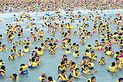 XI'AN, CHINA - (CHINA OUT) <br /> <br /> People Avoid Summer Heat At Water Park<br /> <br /> People play at THEBES Happiness Water World during a continuous high temperature  in Shaanxi, Xi'an province of China. Hot weather with the highest temperature of 36 degree celsius hit Xi'an <br /> it seems there is little room for a swim as hundreds tale to the pool at local swimming centre in China<br /> ©Exclusivepix
