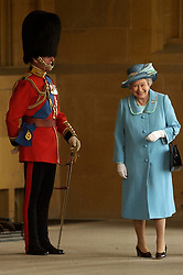 File photo dated 15/04/03 of Queen Elizabeth II and The Duke of Edinburgh at The Queen's Company Review at Windsor Castle. Prince Philip's final public engagement takes place on Wednesday, before he retires at the age of 96.