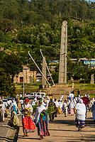 Women returning fom prayer walk in front of the Northern Stelae Park (Obelisk of Axum), Axum (Aksum), Ethiopia.