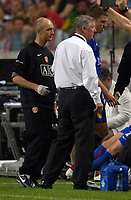 Photo: Daniel Hambury.<br />Ajax v Manchester United. Amsterdam Tournament. <br />05/08/2006.<br />Manchester's Michael Carrick leaves the pitch with an injury watched by Sir Alex Ferguson.