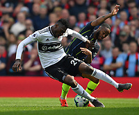 Football - 2018 / 2019 Premier League - Fulham vs. Manchester City<br /> <br /> Fulham's Andre-Frank Zambo Anguissa battles for possession with Manchester City's Raheem Sterling, at Craven Cottage.<br /> <br /> COLORSPORT/ASHLEY WESTERN