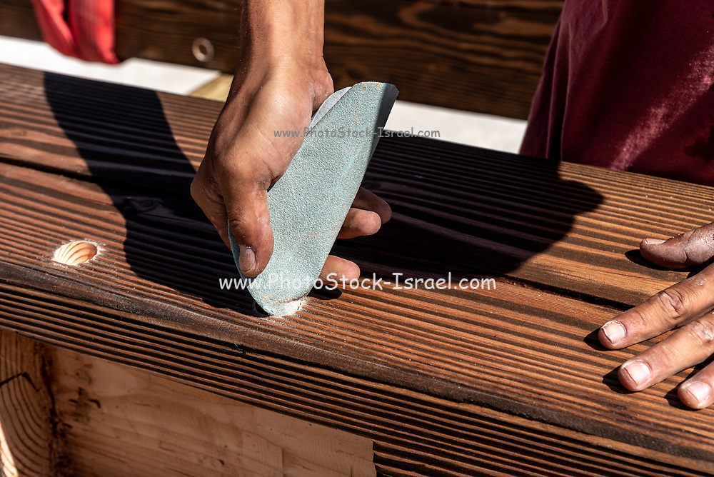 Woodworking. Carpenter is using traditional methods to make furniture