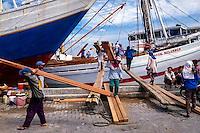 Indonesia, Java, Jakarta. Sunda Kelapa, the old harbor. Workers bringing cargo onshore.