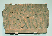 The birth of the Buddha. AD1-200 Ancient Gandhara Pakistan, Schist.  The Buddha's mother Queen Maya stands beneath a shala tree, with the future Buddha emerging from her side.  The god Indra receives the infant.