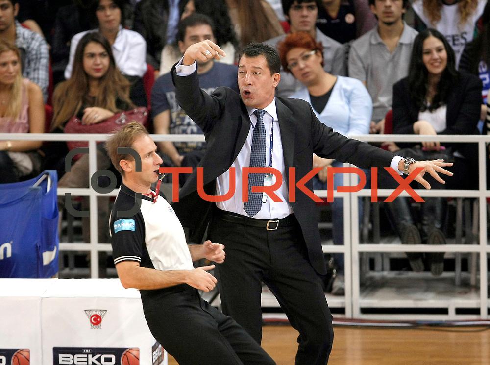 Anadolu Efes's coach Ufuk SARICA (R) during their Turkish Basketball League match Anadolu Efes between Aliaga Petkim at Aliaga Arena in Istanbul, Turkey, Sunday, October 23, 2011. Photo by TURKPIX
