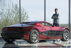ZAGREB, March 22, 2014  Owner of the Rimac Automobili electric vehicles company Mate Rimac poses next to his Concept One electric supercar during an interview at Rimac Automobili headquarters in Sveta Nedelja near Zagreb, Croatia, March 21, 2014. Rimac Automobili is a Croatian company that develops and produces high-performance electric vehicles, drivetrain and battery systems. Rimac Automobili's first model, the Concept One, is known as the world's fastest production electric vehicle. Recently, Rimac started cooperation with several Chinese companies. (Credit Image: © Xinhua via ZUMA Wire)