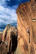 """Big wall climber Chris McNamara on the over hanging """"Tsunami Pitch"""" during the five day first asent of a new route called """"Los Banditos"""" on the Right Twin formation in Zion National Park."""