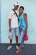 Young couple in the street posing and hugging, Santiago de Cuba, Cuba.