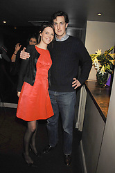 GENEVIEVE CHAPMAN and MARK CHISHOLM at a party to celebrate the 1st birthday of nightclub Kitts, 7-12 Sloane Square, London on 5th March 2008.<br />