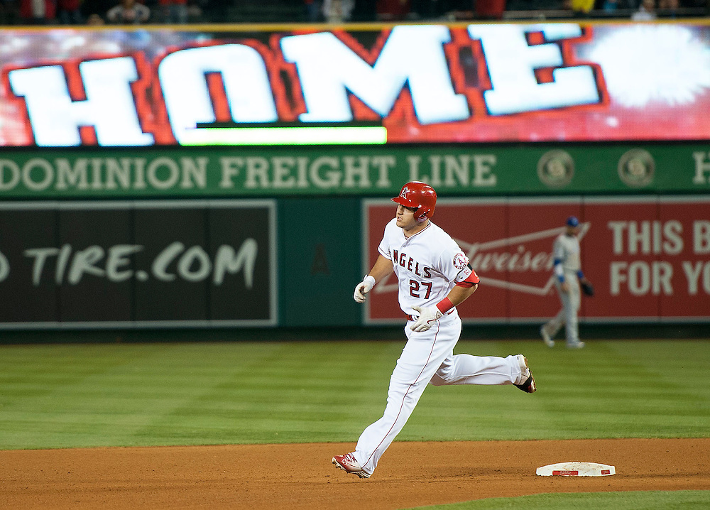 The Angels Mike Trout rounds the bases after his two run home run in the fourth inning against the Kansas City Royals Wednesday night at Angel Stadium.<br /> <br /> ///ADDITIONAL INFO:   <br /> <br /> angels.0428.kjs  ---  Photo by KEVIN SULLIVAN / Orange County Register  --  4/27/16<br /> <br /> The Los Angeles Angels take on the Kansas City Royals Wednesday at Angel Stadium.<br /> <br /> <br />  4/27/16